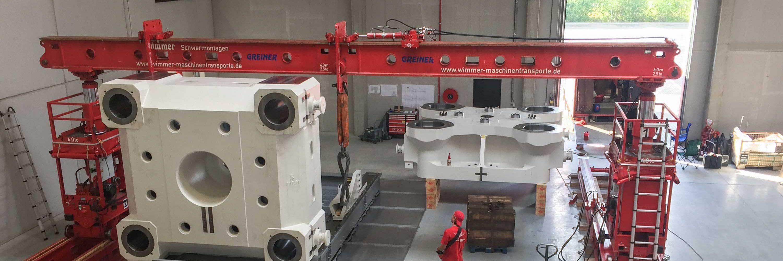 Transport- und Montage von Spritzgießmaschinen Slider